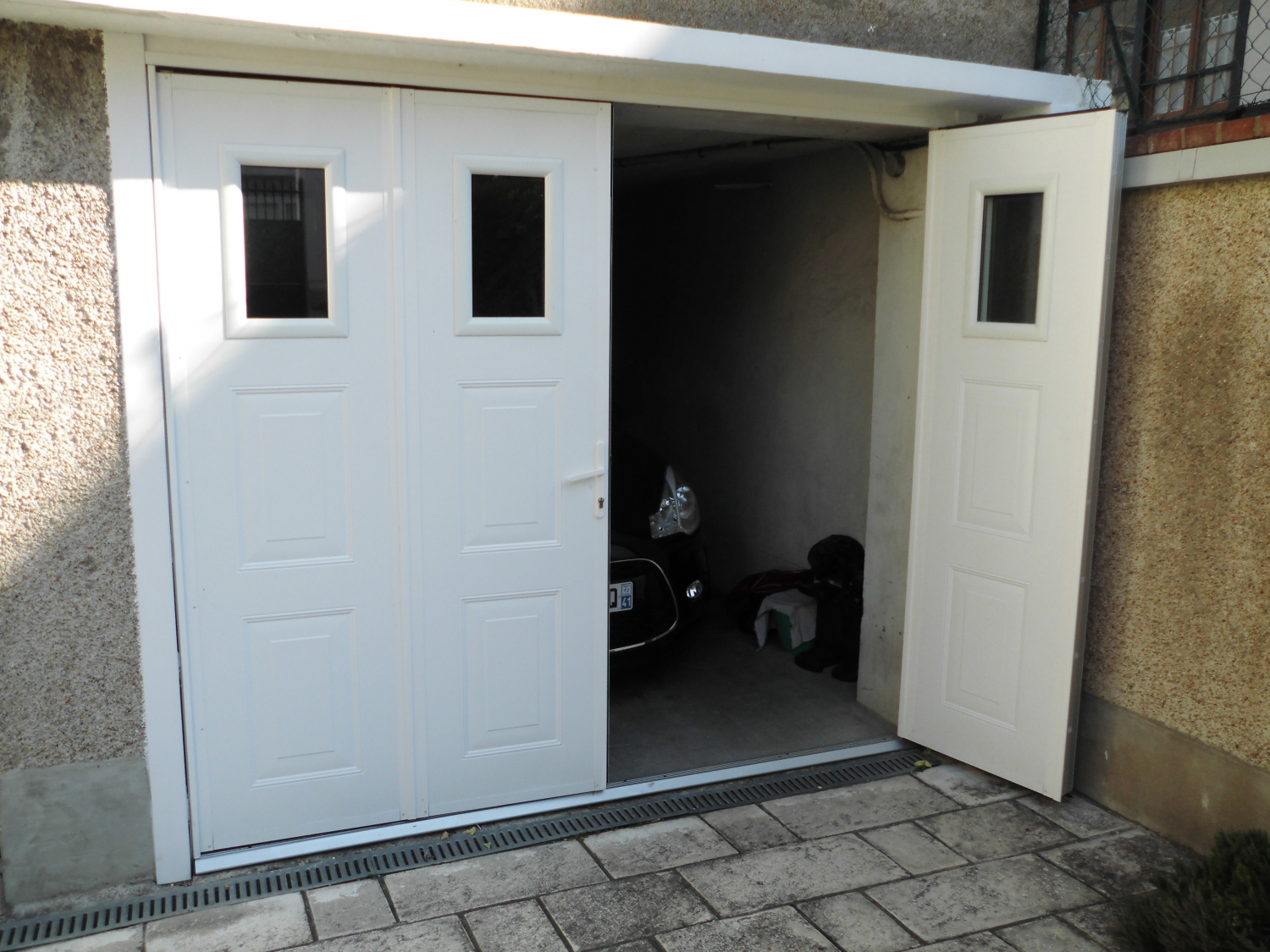 Crystal fenetres produits portes de garage for Double porte de garage